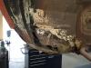 De voorzijde van de wielkuip (front binnen) heeft forse roestschade.
