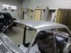 Dak van de Opel afgebeten en geschuurd.